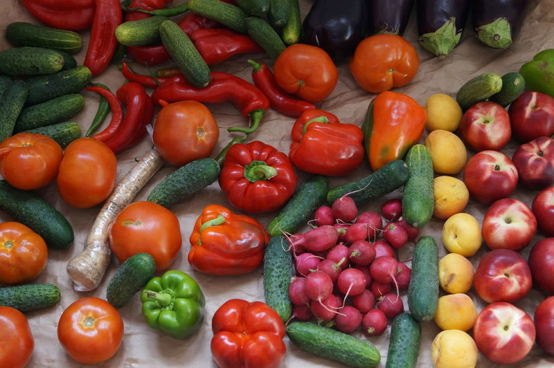 Tomatoes and vegetables for sale at market stall