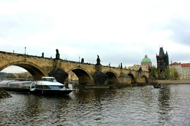 Ship⛴🌉under the Charles Bridge In Prague Bridge - Man Made Structure Architecture Arch Travel Destinations Reflection Built Structure Cloud - Sky Outdoors Water Day MyAdventure Czech Republic Moldau