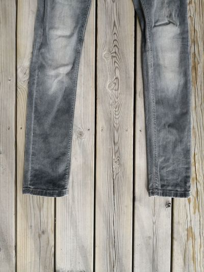 Directly above shot of jeans on wooden table