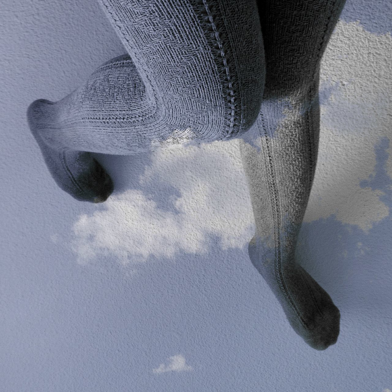 Multiple exposure of legs and clouds on floor