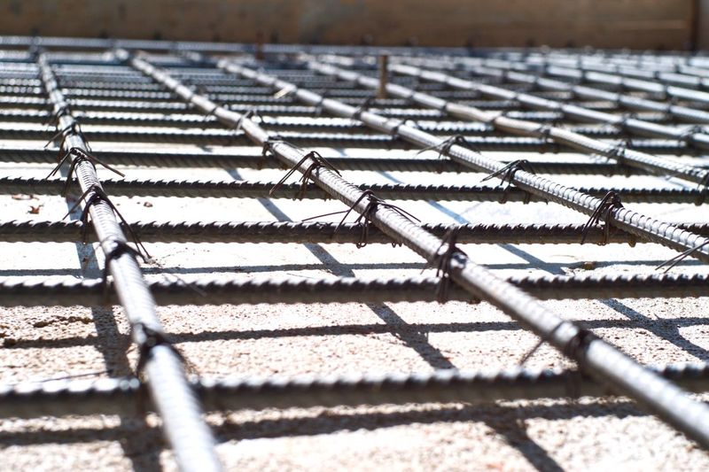 Selective focus picture of steel grid for reinforcement concrete floor at the construction Building Construction Site Structure Reinforcement Steel Pattern Metal No People Shadow Day Sunlight Nature Backgrounds Architecture Full Frame Selective Focus Grid