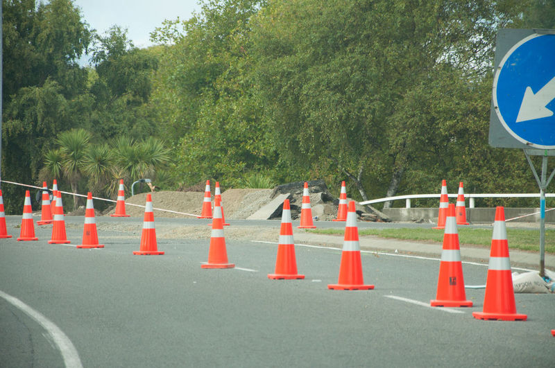 traffic cones on the road Arrow Road In A Row Outdoors Road Cones Road Sign Traffic Cone
