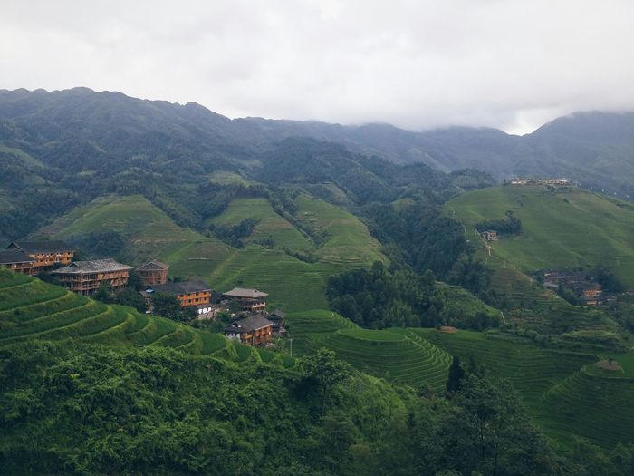 High Angle View Of Longji Rice Terraces Against Cloudy Sky