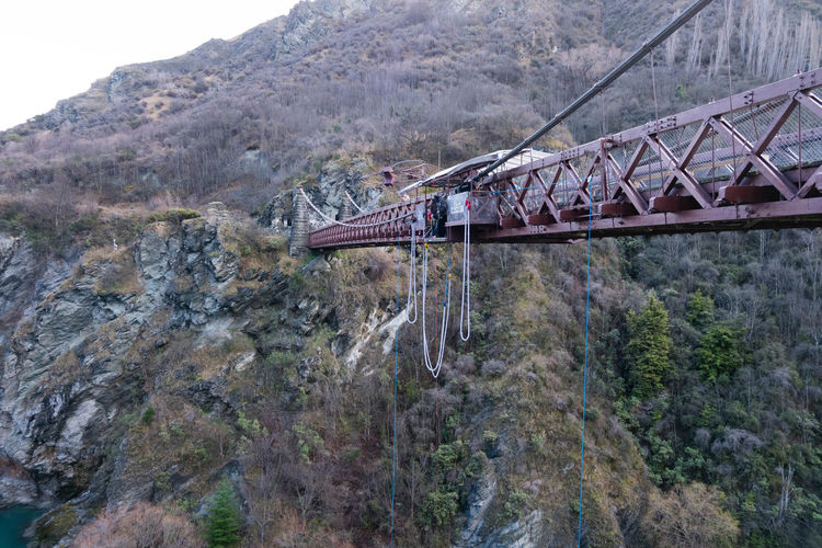 Bungee Jumping Bungy Architecture Bridge Bridge - Man Made Structure Built Structure Connection Day Kawarau River Mountain Nature New Zealand No People Outdoors Plant Rock - Object Sky Transportation Tree