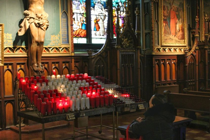 Prayer, Notre Dame Basilica in Montreal Religion Illuminated Place Of Worship Adult Cross Crucifix Jesus Christ Candles Montréal Offering To God Religious  Notre Dame Basilica Montreal Notre Dame Basilica Church Christianity Religious Photography Montreal, Canada Worship