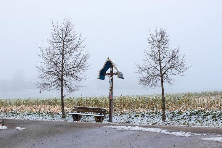 A wooden wayside Cross - wayside cross in Axtbrunn in Bavaria - Germany Catholic Christ Christentum Christian Cross Flurkreuz Nature Old Outdoors Religion Religious  Shrine Wayside Cross Wegekreuz Wintertime Wooden
