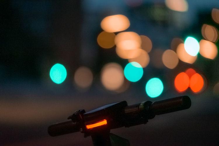 Close-up of bicycle handle at night