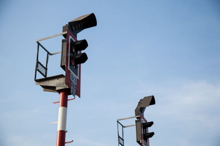 Communication Day Guidance Low Angle View No People Outdoors Railway Signal Road Sign Signal Sky Surveillance Technology