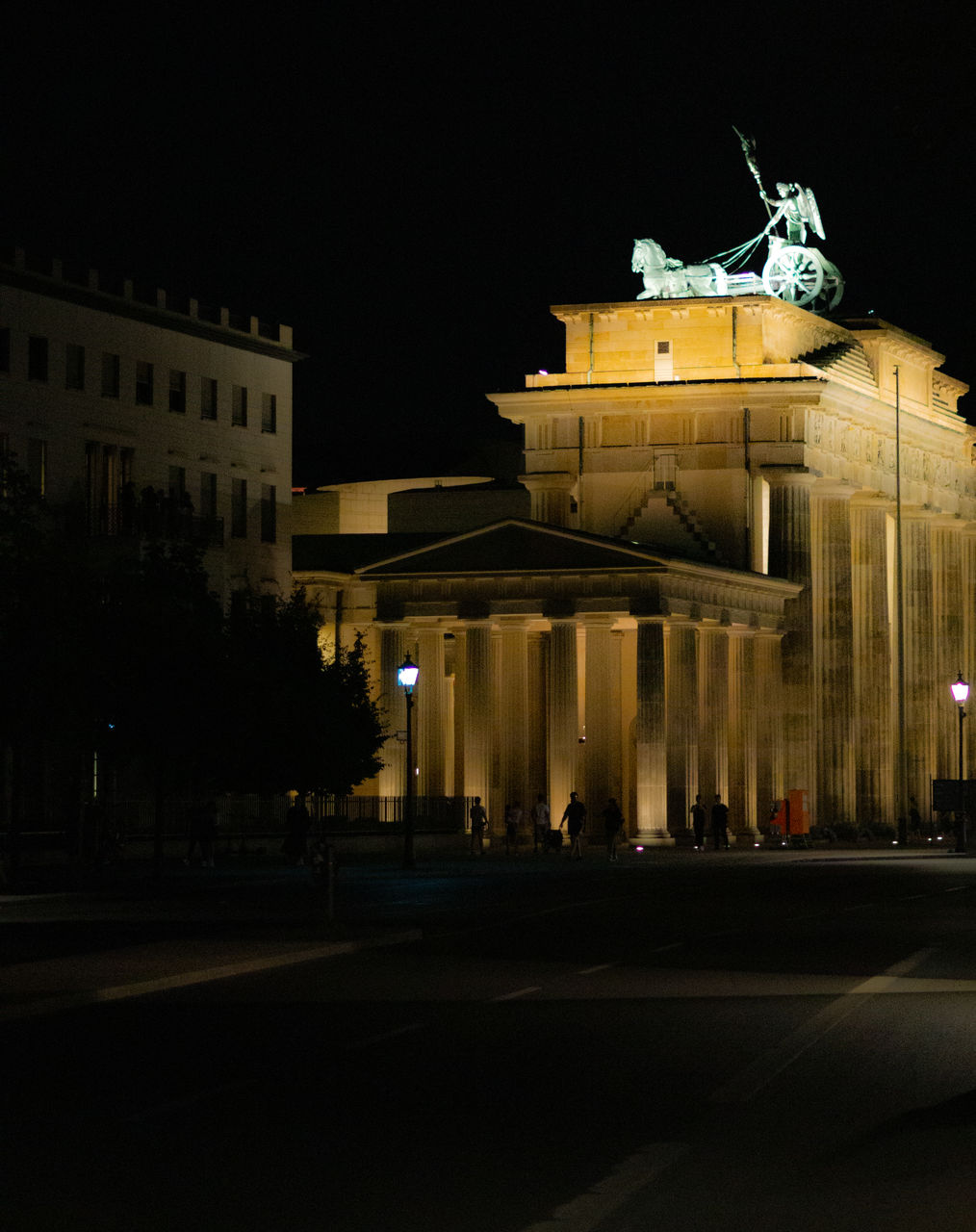 night, architecture, building exterior, built structure, illuminated, city, history, street, the past, nature, building, travel destinations, sky, sculpture, travel, statue, incidental people, city life, tourism, architectural column, city gate