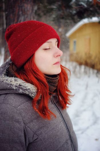Portrait of woman in hat during winter