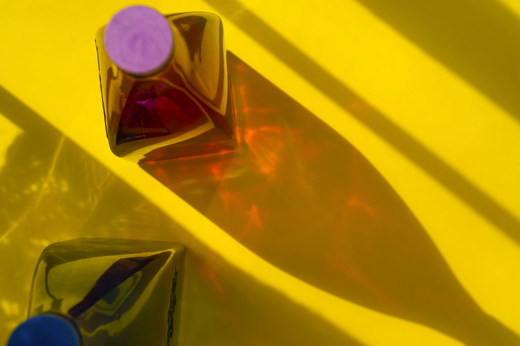 High angle view of yellow mirror on glass