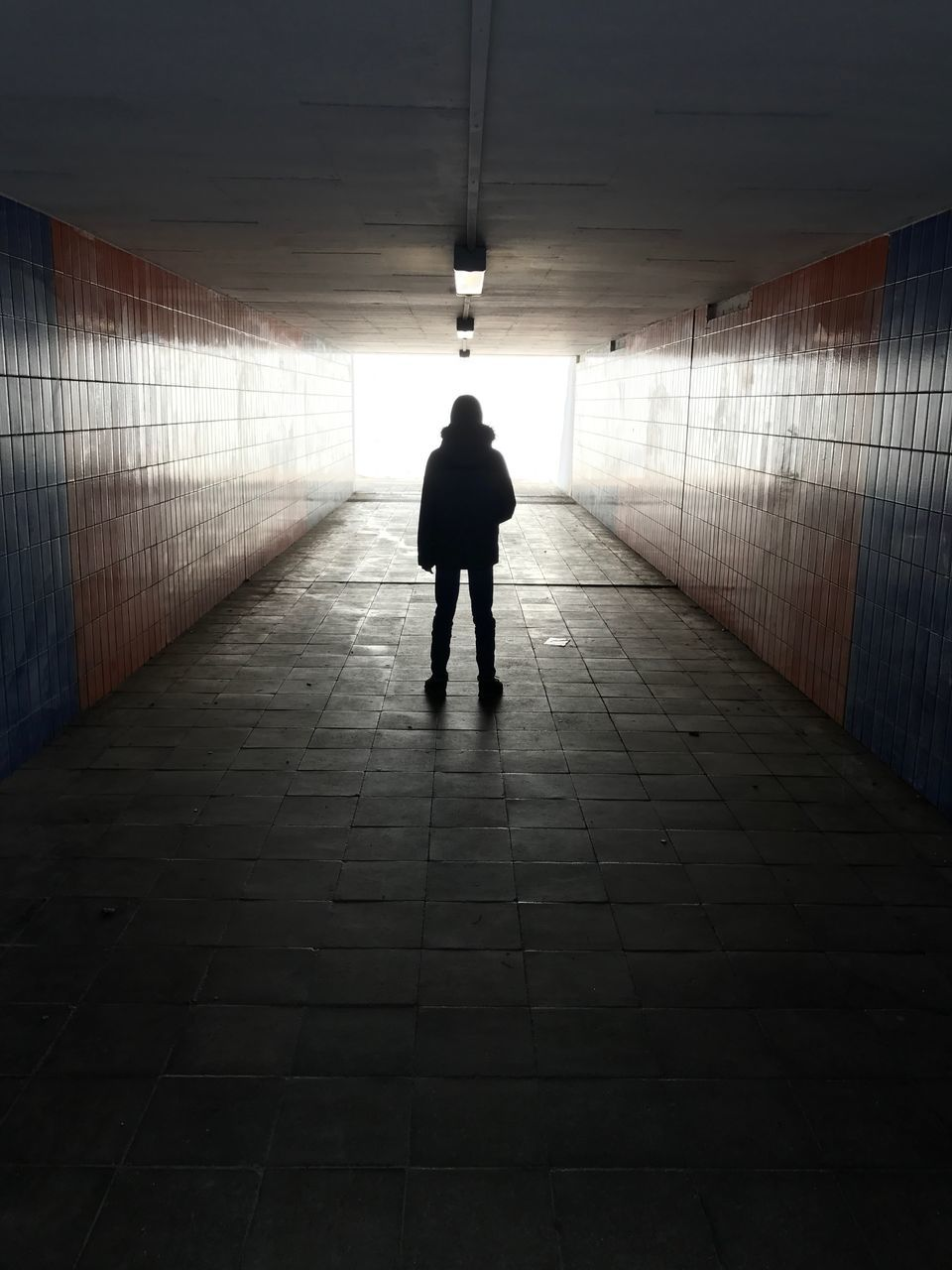 full length, silhouette, real people, rear view, one person, the way forward, indoors, walking, architecture, men, standing, built structure, illuminated, day, people