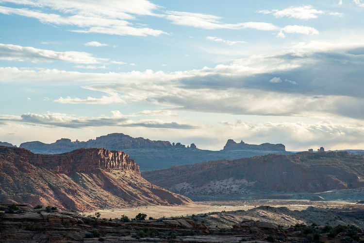 Rock formations against cloudy sky at arches national park