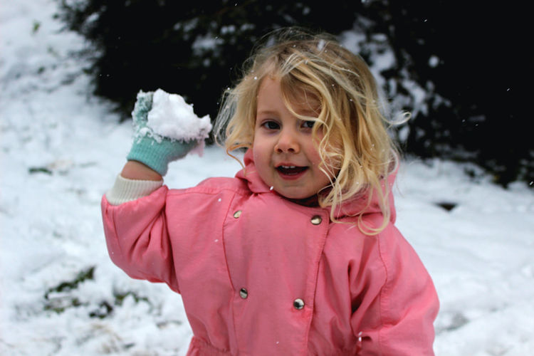Snowball fight in the garden