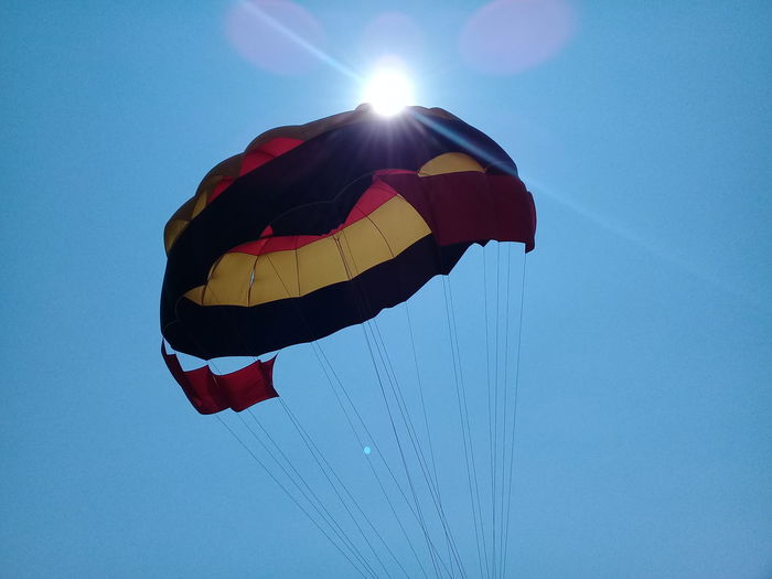 Playa linda Sun Blue Low Angle View Arts Culture And Entertainment Outdoors Traditional Festival Clear Sky Motion Sky Parachute Summer Multi Colored No People Nature Paragliding Day Winter Beauty In Nature Parachute Flying Parachute