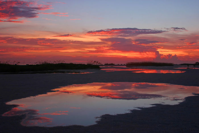 Beauty In Nature Cloud - Sky Dramatic Sky Florida Gulf Of Mexico Moody Sky Nature No People Orange Color Reflection Saint Petersburg Florida Scenics Sky Standing Water Sunset Tampa Bay Tranquil Scene Tranquility Treasure Island FL Water