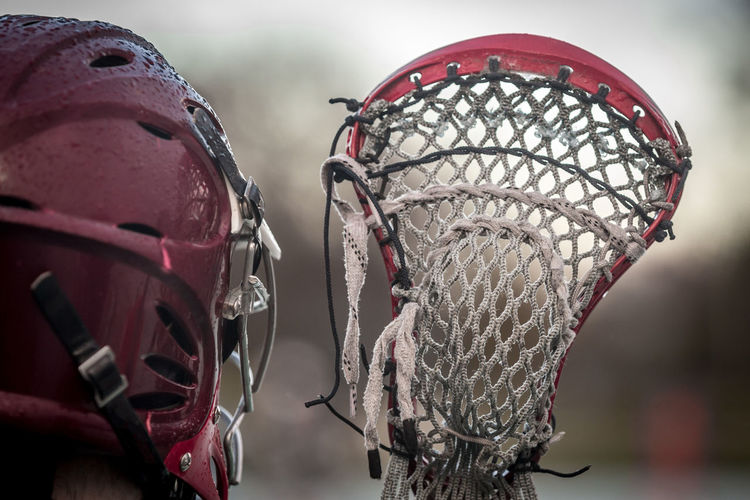 Close up of person holding lacrosse stick