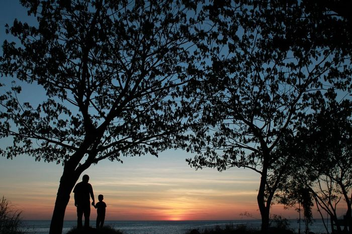 Father and his son are enjoying the Sunset . Living Bold Snapshots Of Life