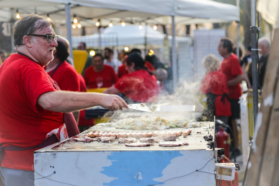 Cooking Festival Season Palma Palma De Mallorca Day Festival Food Food And Drink Freshness Incidental People Market Market Stall Meat Men Occupation One Person Outdoors People People And Places People Cooking Ready-to-eat Real People Smoke - Physical Structure Standing Street Photography