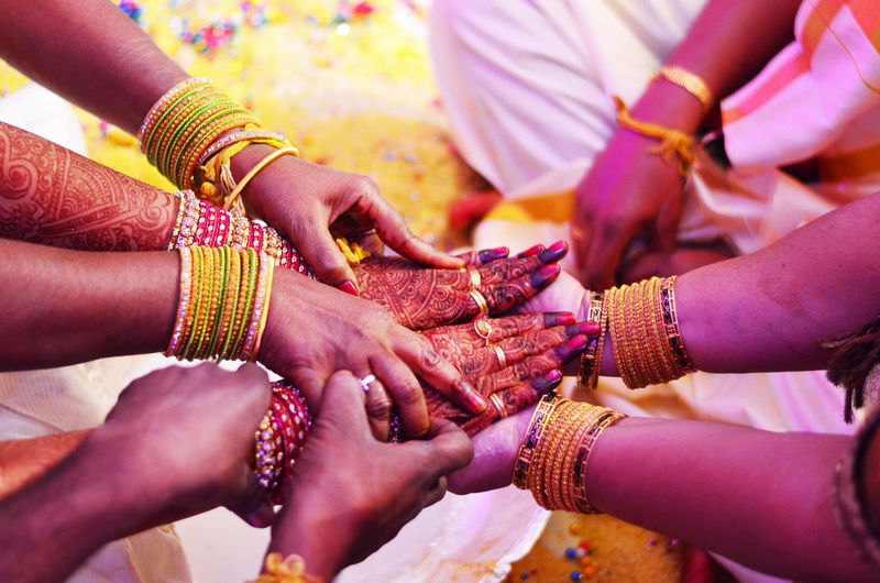 Close-Up Of Female Hands Performing Indian Wedding Traditions