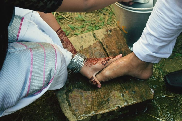 Welcoming bridegroom by washing feet in chakma traditional marriage rituals