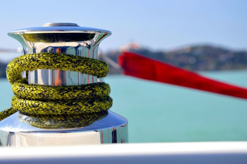 Close-up of rope handle on boat in sea
