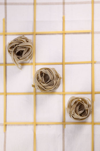 Directly above shot of raw pasta arranged on table