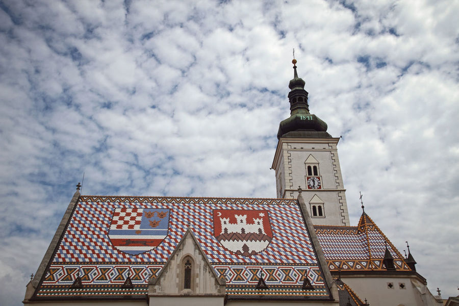 Architectural Feature Architecture Building Exterior Built Structure Church Cloud Cloud - Sky Cloudy Croatia Day High Section Low Angle View No People Outdoors Place Of Worship Religion Sky Spirituality Tall - High Tourism Travel Destinations Zagreb