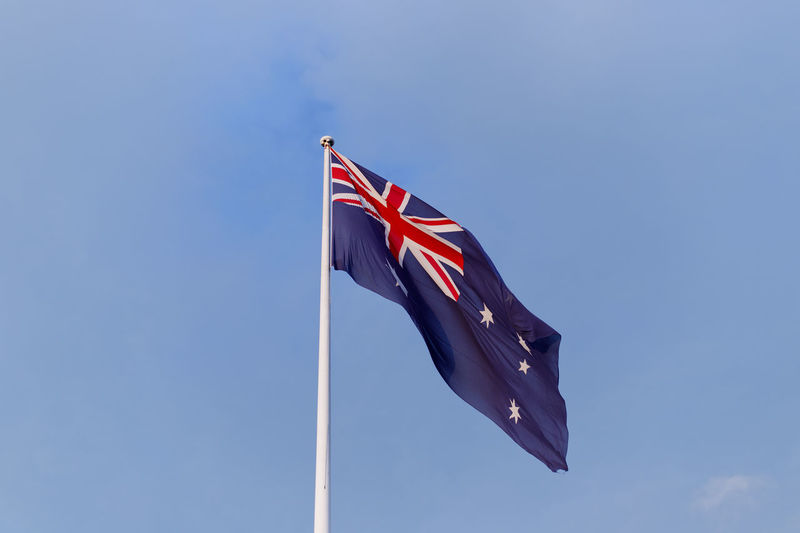 Low angle view of australian flag against blue sky