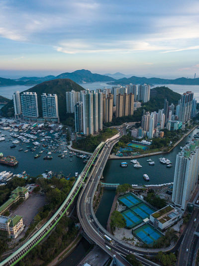 Aerial view of the Aberdeen Harbour in hong kong Aberdeen Dragon Hongkong Photos Aerial Photography Aerial View Architecture Boat Building Building Exterior Built Structure City Cityscape High Angle View House Modern Mountain Nature Office Building Exterior Outdoors Sea And Sky Sky Skyscraper Sunset Transportation Water
