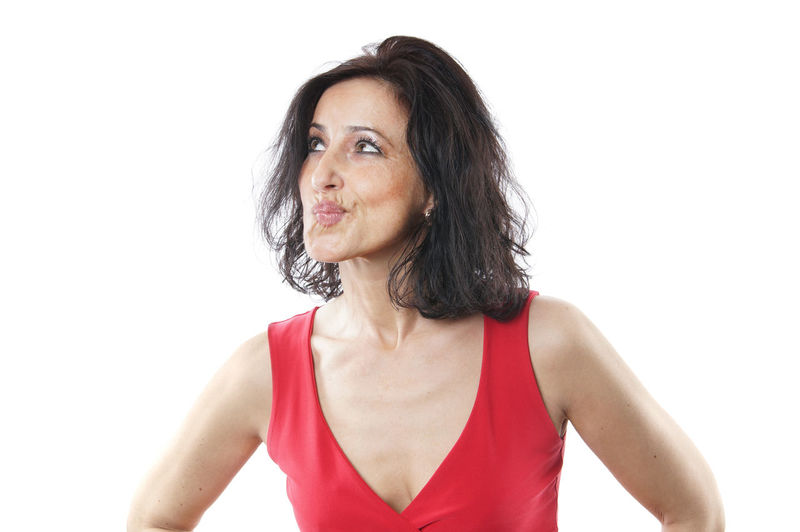 Looking Away Pouting Spanish Top Woman Brunette Casual Clothing Female Mid Adult Middle Aged One Person Pout Real People Sceptical Sleeveless  Studio Shot White Background