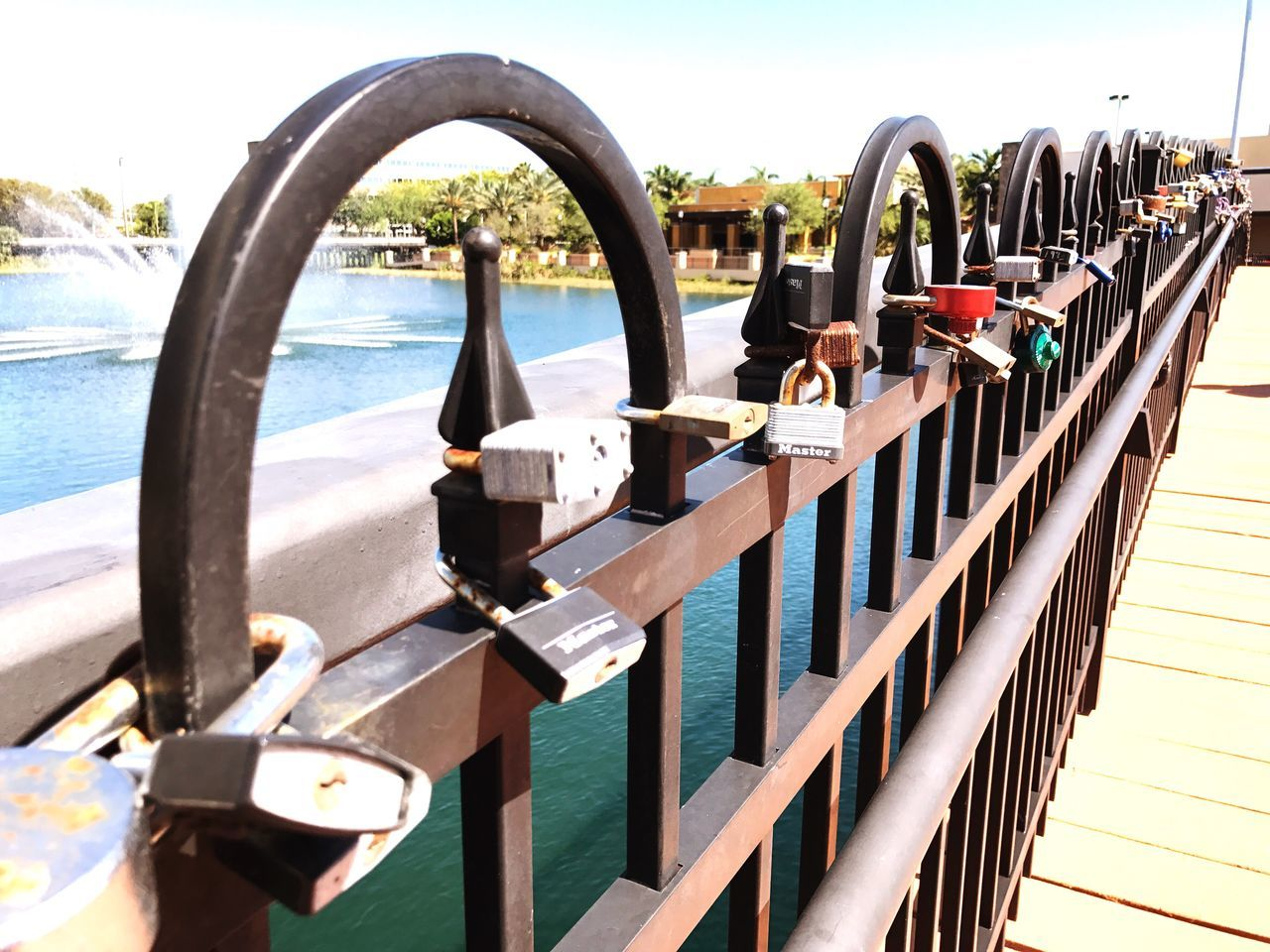padlock, railing, lock, metal, love lock, security, safety, water, day, outdoors, river, no people, sunlight, bridge - man made structure, sky, nature, clear sky, nautical vessel, close-up
