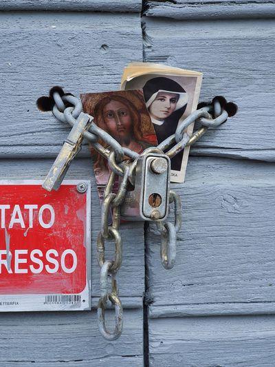 Portrait of padlocks on metal chain