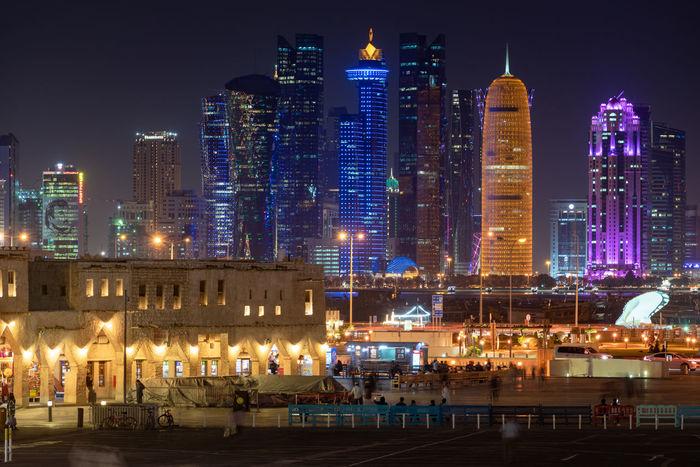 Building Exterior Architecture Illuminated City Night Cityscape Skyscraper Travel Destinations Doha Qatar Gulf Souq Waqif Bazar Market Old And New Heritage Skyline Shops Shopfronts
