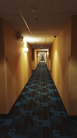 Never Ending Hallway The Way Forward Illuminated No People Creepy Hall Indoors  Architecture Ceiling Floor