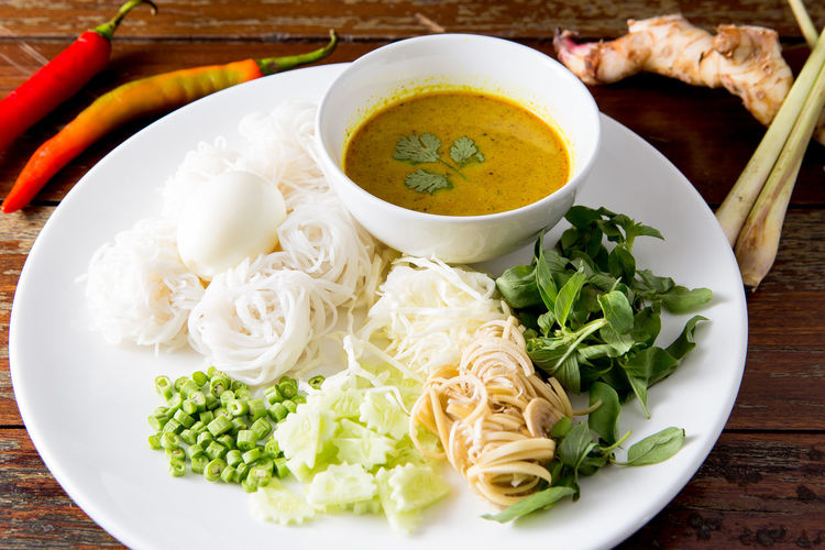 Noodle with fish curry sauce Spicy Spicy Food Thai Traditional Food Bowl Fish Curry Fish Curry Sauce Food Food And Drink Freshness Healthy Eating Noodle Plate Soup Still Life Table Thai Food Vegetable