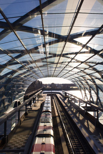 Architecture Transportation Built Structure Rail Transportation Track Railroad Track Indoors  Ceiling Day No People Mode Of Transportation Public Transportation Railroad Station Travel Metal City Pattern Sunlight Diminishing Perspective Modern Train Station