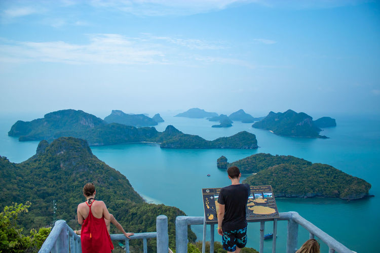 The tourists on the point of view of the sea at Angthong Islands , Suratthani in Thailand 30 March 2018. Water Real People Mountain Beauty In Nature Leisure Activity Scenics - Nature Rear View Lifestyles Women Two People Men Nature Sky Adult Sitting Day Tranquility People Tranquil Scene Looking At View Outdoors Couple - Relationship