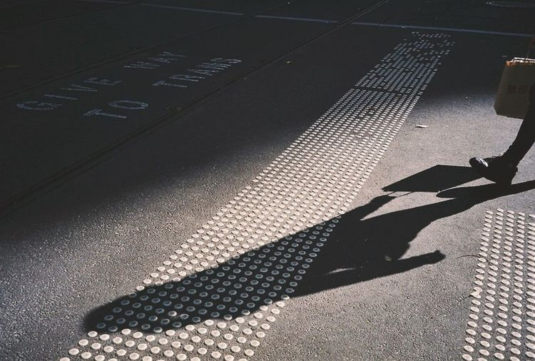 High angle view of shadow on street in city