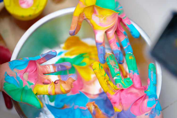 Close-up of hand holding multi colored painting