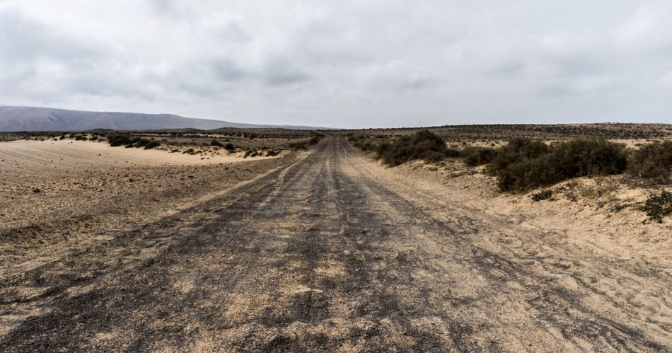 Never ending road. Landscape The Way Forward Sky Nature Tranquil Scene Outdoors Scenics Non-urban Scene Tranquility No People Day Road Cloud - Sky Arid Climate Beautiful Nature SPAIN Lanzerote Full Frame Sand Dessert
