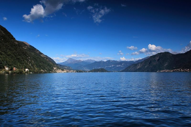 Travel Photography Beauty In Nature Blue Day Italy Lake Lake View Landscape Mountain Mountain Range Nature No People Outdoors Range Rippled Scenics Sky Tranquil Scene Tranquility Water Waterfront