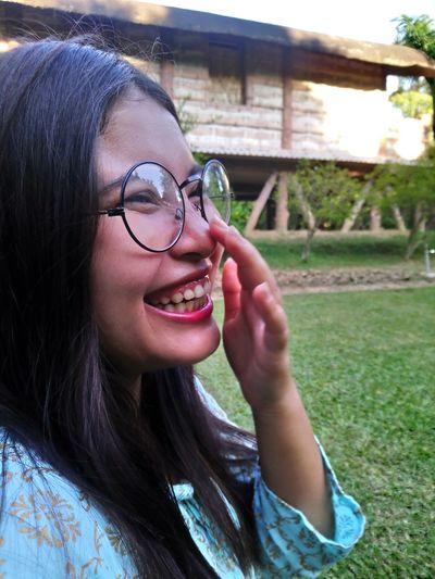 Close-up of cheerful woman at park