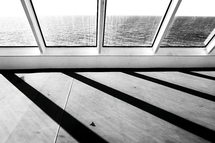 Travellers Ocean Landscape Travel Photography Full Frame Canada Travel Photography Black And White Photography Reimerpics British Columbia Vancouver Island Bcferries Strait Of Georgia Window No People Indoors  Day Modern Built Structure Architecture Close-up Shadows & Lights