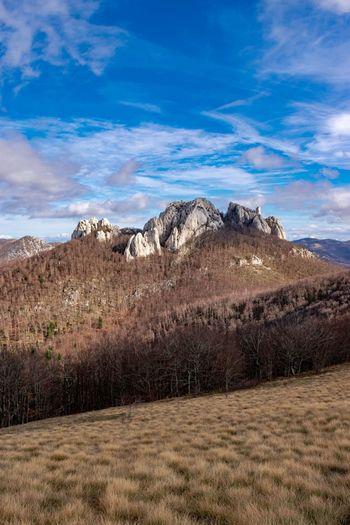 Bačić kuk on the Velebit mountain in Croatia Nature Nature Photography Croatia Wilderness Clouds Forest Mountain Sky Landscape Cloud - Sky Mountain Range Scenics Idyllic Non-urban Scene Rock Formation Tranquility Tranquil Scene