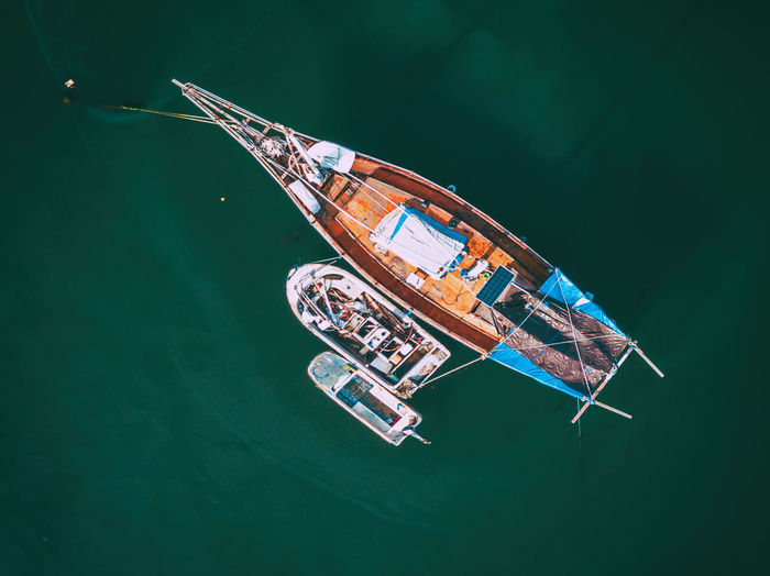 Wooden Sailboat anchored on shore waiting for an another adventure Drone  From Above  Wooden Boat Aerial View Close-up High Angle View Liveaboard Mode Of Transport Nautical Vessel No People Sailboat Sailing Sailor Sea Life Transportation Vessel Water Waterfront Be. Ready. EyeEmNewHere Drone  Outdoors Boat View From Above Small Boat Perspectives On People AI Now EyeEm Ready