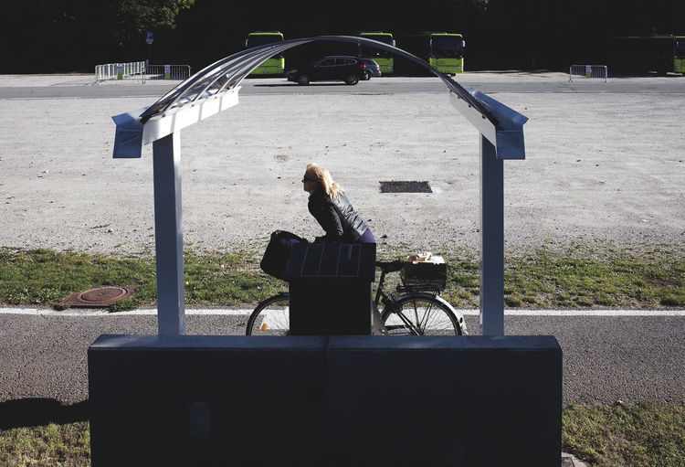Autumn Bicycle Bicycling Day Dramatic Angles Everyday Lives Park Park - Man Made Space Parking Lot Passing By Solitude Urban Landscape Woman