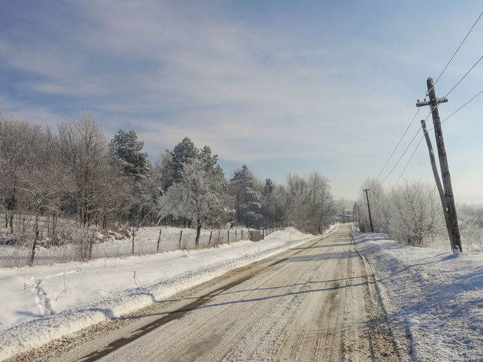 Bare Tree Beauty In Nature Cable Cloud - Sky Cold Temperature Day Electricity Pylon Field Landscape Nature No People Outdoors Road Scenics Sky Snow The Way Forward Tranquility Transportation Tree Winter