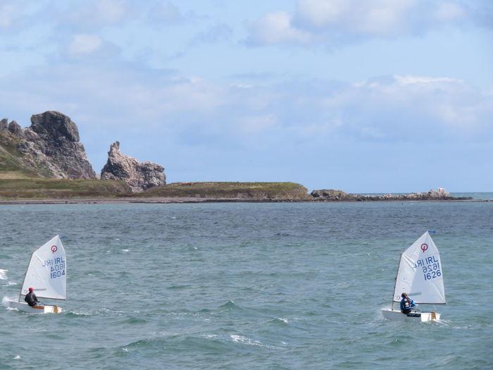 People windsurfing on sea