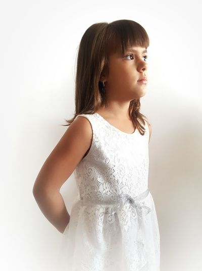 Girl standing against white background